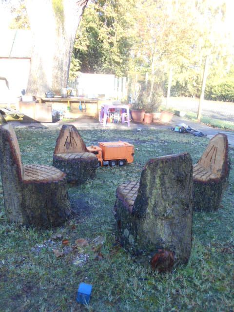 seats carved from logs in a nursery playground