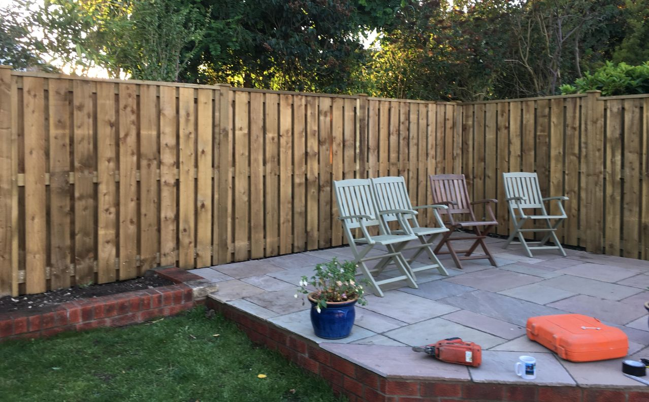 A new fence installed in a garden